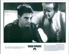 """Agent Ethan Hunt (Tom Cruise) is advised by his mentor, Jim Phelps (Jon Voight), in the film """"Mission: Impossible""""."""