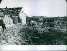 A photo of men in the grounds of Lebanon that was bombed during Civil War.