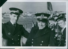 """Lieutenant Sevellec and the other officers standing on the Sirocco warship and smiling.  """"French warship Sirocco""""  1940"""