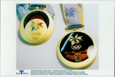 The Gold Medal for the Winter Olympics 1998, shown from both sides