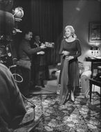 Carroll Baker standing at shooting location.