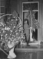 Man carrying a large bouquet.
