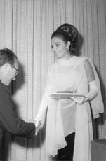Farah Pahlavi with a man.