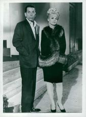 Carroll Baker standing with Jhon Conti posing for the camera.