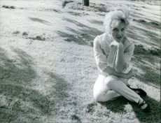 Woman siting in the park and posing.