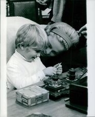 Ulla Jacobsson looking at her child playing. 1967.