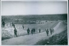 Finnish Troops 1941 Suurmakis conquered avaneera rifle and mind HELP span along a odemarksvag
