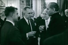 Alexei Nikolayevich Kosygin having a conversation with unknown men at a party at a party. 1966.