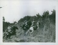 Soldiers in attacking position with their horses during war. 1935.