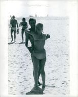 Woman hugging Dieter Dengler in the beach.
