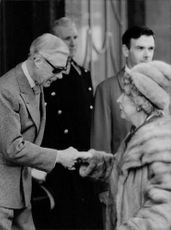 The Duke of Windsor taking a lady's hand