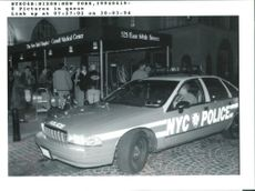 Police and members of the press wait outside newyork hospital.