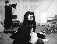 A nuns helping fainted woman.