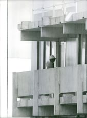 Man standing on the balcony of the building, 1972.