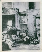 A Neapolitan couple makes the best of life in their bomb-wrecked home. 1944.