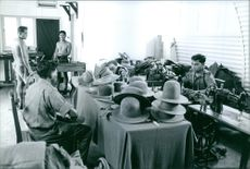 Hats being made by Gurkhas.