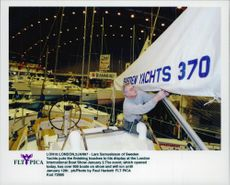 Lars Samuelsson fixes the last of his yatch before the exhibition opens.