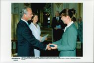 Magdalena Forsberg receives the HM King's medal of the 8th size in high-blue band by King Carl XVI Gustaf.