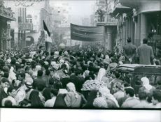 Demonstrators occupying the streets holding their banners and flag in Baghdad, January 1960.