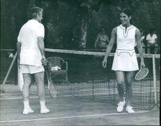 Jacques Chaban-Delmas playing a tennis with a woman, 1971.
