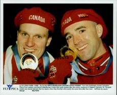 Canadian Boyfriends Pierre Fritz and David G MacEachern Hold Up Their Gold Medals During the Winter Olympics 1998