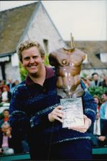 Golf player Colin Montgomerie with the trophy after winning the Lancome Trophy in 1995