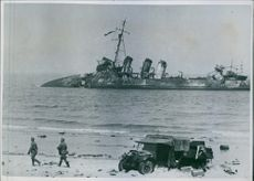 Dunkerque : A destroyed Ship in the sea from western war memorial during the war in France. 1937