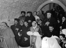 Pope Paul VI standing with his companions.