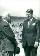 John Malcolm Fraser standing with a man. Photo taken 1977