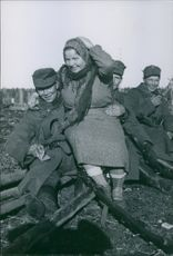 Finnish soldier with a woman trap in the woods.