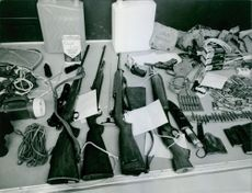 Weapons lying on the table.