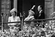 Juliana, Queen of the Kingdom of the Netherlands  with her family on terrace.
