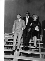 Ray Charles stepping down staircase with woman.