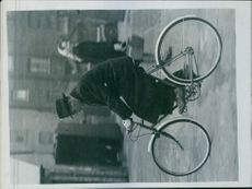 Latysho trying out his bicycle that was presented to him by Claude Butler, the bicycle manufacturer.