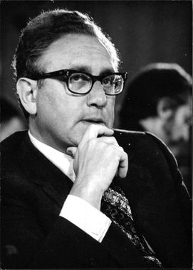 Henry Alfred Kissinger sitting thoughtfully.