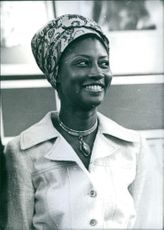 Mrs. Beverly Manley, looking away, smiling.