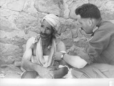 A military man speaking to a homeless man affected by the Algerian War. The Algerian War, also known as the Algerian War of Independence or the Algerian Revolution  was a war between France and the Algerian independence movements from 1954 to 1962, which