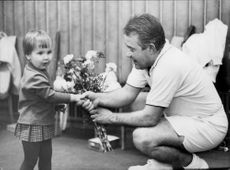 The tennis veteran Torsten Johansson receives flowers from a little girl