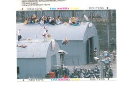 Vietnamese boat people in hong kongs high island camp stage a protest on the roofs of huts at the detention centre may 11.