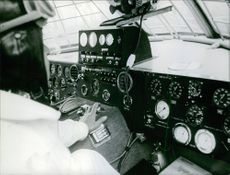1967 Pilot siting and getting trained in the airplane.