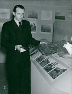 One of the Maritime Museum officials shows some oil shale