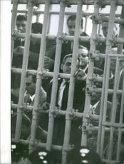 People standing in the confined structure.