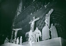 Sculpture of the crucifixion of Jesus Christ and the two thieves. in Notre Dame, 1962.