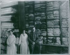 A photo of two woman with a man in the garments factory.