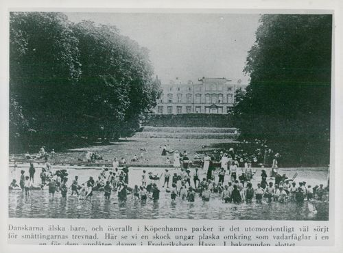 Photography from a book from Frederiksberg Garden where children splash in a pond with the castle in the background