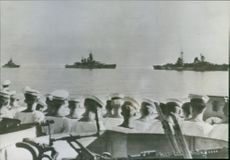 The cruiser Savoia, a flagship, leads two battleships, the Venita and the Italia, as the major units of the Italian Navy steam toward an Allied port to surrender to the United Nations 1945 Italy.