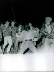 People dancing and enjoying together. 1961