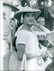 Miss France wearing a hat and smiling during Miss World contest in Los Angeles.