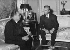 Mohammad Reza Pahlavi having conversation with a man.  - Oct 1964