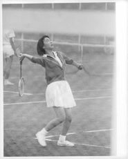 Princess Michiko (now an Empress) is playing tennis with Emperor Akihito.
